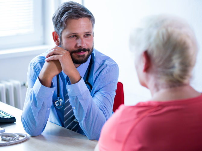Patient consulting a doctor at the hospital
